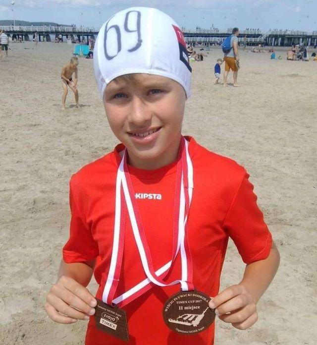 Malbork : Drugie miejsce Jakuba Grapentyna z MAL WOPR w Wyścigu Pływackim Dookoła Molo Timex Cup 2017 - 29.07.2017